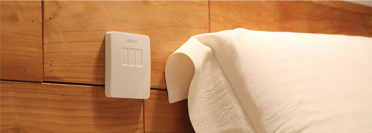 Smart Home smart light switch on wall beside bed